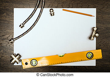 Schmierwerkzeuge auf einem weißen Blatt Papier