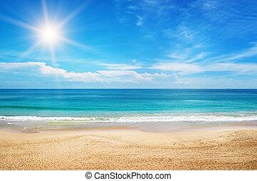 Seascape and sun on blue sky background.