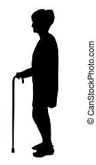 Silhouette der ältesten Frau mit Brille, die mit Stock geht.