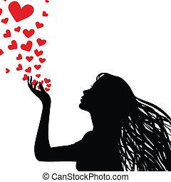 Silhouette, die Herzen bläst