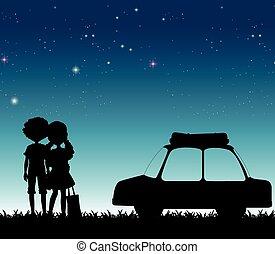 Silhouette-Paar bei Nacht.