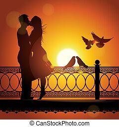 Silhouette von Paaren, die sich am Sonnenuntergang küssen