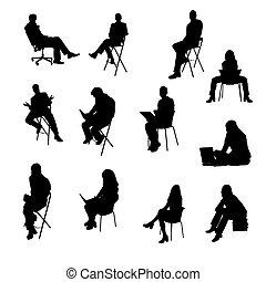 Silhouette von sitzenden Geschäftsleuten