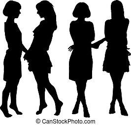 Silhouette von zwei jungen, schlanken Frauen.
