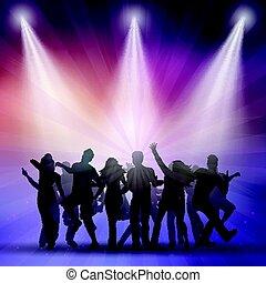 Silhouetten von Leuten, die tanzen.
