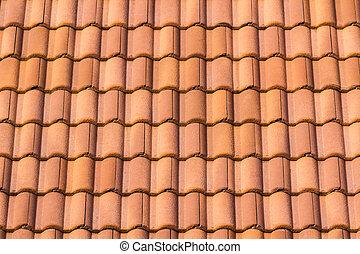 Sitzlose, orangene Dachziegel.