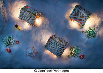 Snowy Lebkuchen Hütte mit Santa und Geschenken.