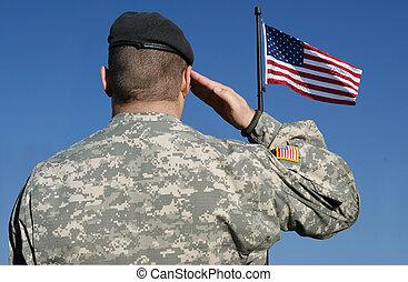 Soldat salutiert vor Flagge