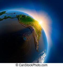 Sonnenaufgang über der Erde im Weltraum