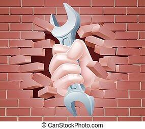 Spanner Hand bricht durch die Wand.