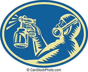 Spray Maler, der die Waffe nach hinten sprüht