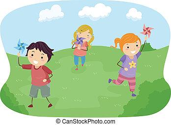 Stickman-Kinder spielen mit Windrädern auf einem Feld