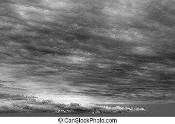 Stormy clouds cloudscape dark grau cloudy day.