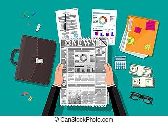 Tägliche Zeitung in den Händen