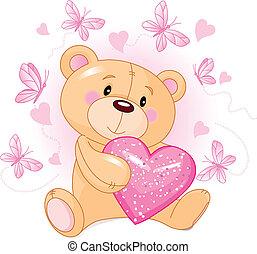 Teddybär mit Liebesherz.