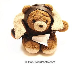 Teddybär Pilot mit einem Papierflugzeug, isoliert im weißen Hintergrund