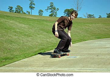 Teen Skater Downhill.