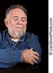 Trauriger alter Mann