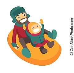 Vater mit Sohn schleicht sich auf Schneekautschukrohr.