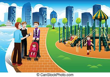 Vater und ihre Kinder auf dem Spielplatz.