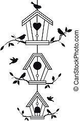 Vogelhäuser mit Baumästen.