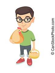 Weißer Junge mit Hühner- und Hühnereiern.
