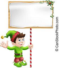 Weihnachtself mit Zeichen.