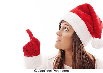 Weihnachtsfrau zeigt auf Kopien