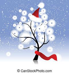 Weihnachtshut auf dem Winterbaum.