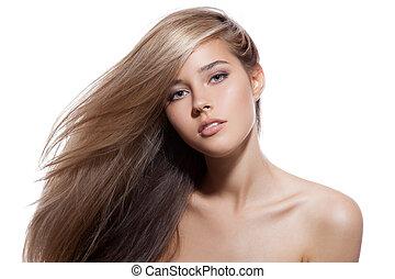Wunderschönes blondes Mädchen. Gesundes langes Haar. Weißer Hintergrund