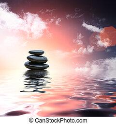 Zensteine, die im Wasserhintergrund reflektieren.
